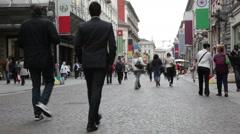 Pedestian traffic through Milan city street Stock Footage