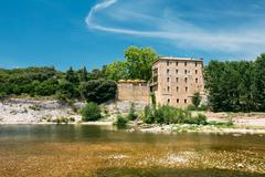 Old House Near Ancient Roman aqueduct of Pont du Gard, Nimes, France Stock Photos