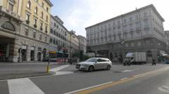Cars driving in Piazza San Giovanni in Trieste Stock Footage