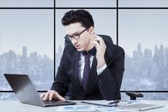 Entrepreneur concentrating working with laptop Stock Photos
