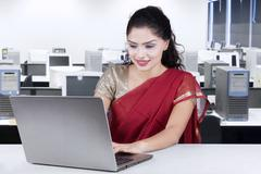 Indian woman working in office with traditional clothes Stock Photos