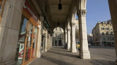 Vodafone and Camiceria shops in Piazza Carlo Goldoni in Trieste Stock Footage
