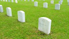 US military cemetery with many marble headstones of unknown soldiers graves Stock Footage