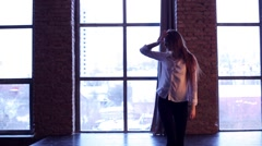 Girl's silhouette against a big window Stock Footage