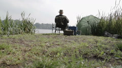 A pensioner is enjoying a day fishing - stock footage