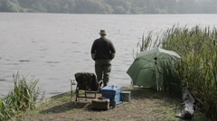 A pensioner is enjoying a day fishing Stock Footage