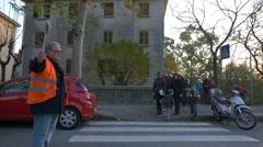 People and children crossing Via Giovanni Schiaparelli in Trieste Stock Footage