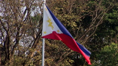 Philippine flag flies near the Rizal Monument Stock Footage