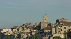 Church tower and other buildings on a hill in Vence, France Stock Footage
