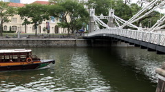 Tour Boat passes under the Cavenagh Bridge Stock Footage