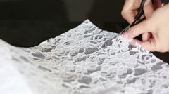 Hand cut white fabric with scissors of dressmaker cutting a cloth Stock Footage