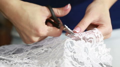 Hand cut white fabric with scissors of dressmaker cutting a cloth Arkistovideo