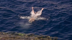 Girl dives in the red sea Stock Footage