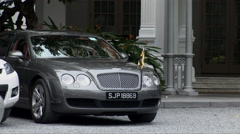 Bentley Limousine in the courtyard of Raffles - stock footage