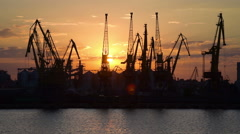 Trading port at Odessa, cranes at sunset, Ukraine, industrial background - stock footage