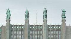Four statues placed on Brussels Expo building's top in Brussels - stock footage