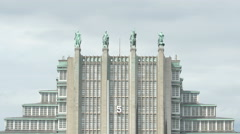 Four sculptures placed on Brussels Expo building's top in Brussels Stock Footage