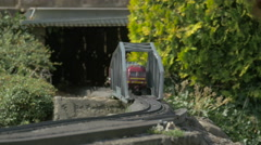 A passenger train crossing a bridge displayed at the Mini-Europe, Brussels - stock footage
