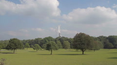 A shot of heavy industry with air pollution set in a pretty rural location. - stock footage