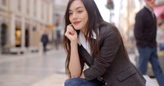 Young woman sitting waiting for someone Stock Footage