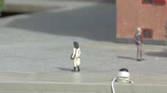 Two plastic figurines next to a building displayed at the Mini-Europe, Brussels Stock Footage