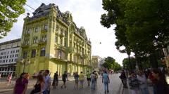 Ukraine, Odessa, Deribasovskaya Street, big Moscow Hotel,  pedestrians walking Stock Footage