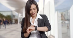 Young woman checking her wristwatch for the time Stock Footage