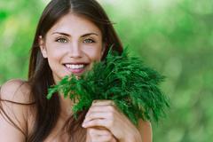 portrait beautiful young woman green dill - stock photo