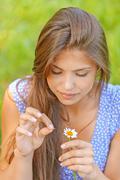 Woman wonders on flower Stock Photos