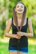 young, long-haired woman - stock photo