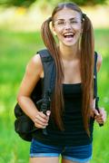 Happy young woman with backpack Stock Photos