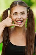 portrait of young woman speaking on imaginary phone - stock photo