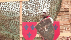 Knight in armor with sword and shield Stock Footage