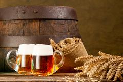 Two beer glasses with bundle of wheat Stock Photos