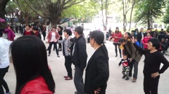 During the Spring Festival in China, people are dancing and singing in the park. Stock Footage