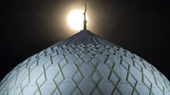 Dome of The Hazrat Sultan Mosque in Astana timelapse at night with full moon Stock Footage