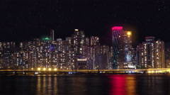 Modern city landscape at nigh with sky filled with stars timelapse. Stock Footage