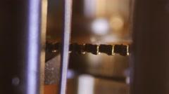 Cogwheels of an antuque clock, macro closeup, 4K Ultra HD - stock footage