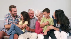 Cute multi generation family playing on the couch - stock footage