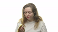 Fatty woman eating banana, sixth video - stock footage