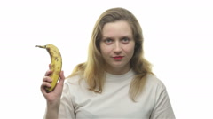 Fatty woman showing banana, video - stock footage