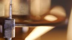 Stock Video Footage of Cogwheels of an antique clock, macro closeup, 4K Ultra HD