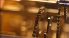 Stock Video Footage of Cogwheels of an antuque clock, macro closeup, 4K Ultra HD