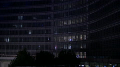 Night tilt up view of the European Commission building in Brussels Stock Footage