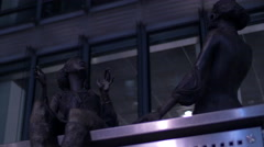 Statues seen at night, outside the EU Charlemagne building in Brussels Stock Footage