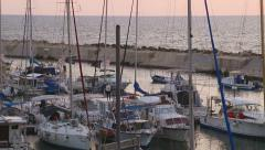 Illustrative documentary. Coming Sailing fishers boat in port Jaffa. Traffic - stock footage