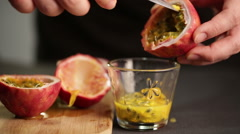 Chef cuts a passion fruit to extract juice and seeds - stock footage