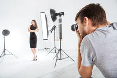 Stock Photo of Photographer working with model in studio