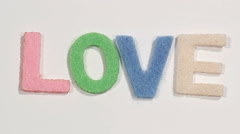 "Felt letters ""LOVE"" on white background. Defocus. - stock footage"