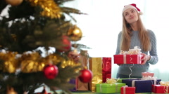 Portrait of happy girl with X-mas presents at home - stock footage